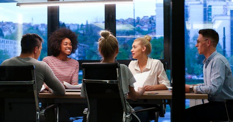 storyblocks-multiethnic-startup-business-team-on-meeting-in-modern-night-office-interior-brainstorming-working-on-laptop_SO8FzwIdhb.jpg